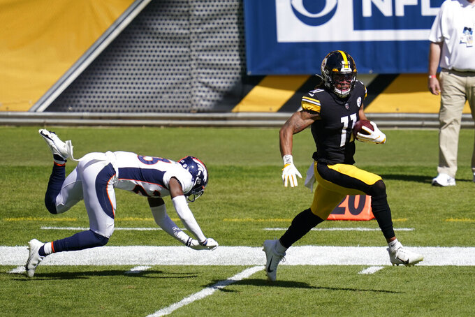 Pittsburgh Steelers wide receiver Chase Claypool (11) gets past Denver Broncos cornerback Michael Ojemudia (23) on an 84 yard touchdown play during the first half of an NFL football game, Sunday, Sept. 20, 2020, in Pittsburgh. (AP Photo/Keith Srakocic)