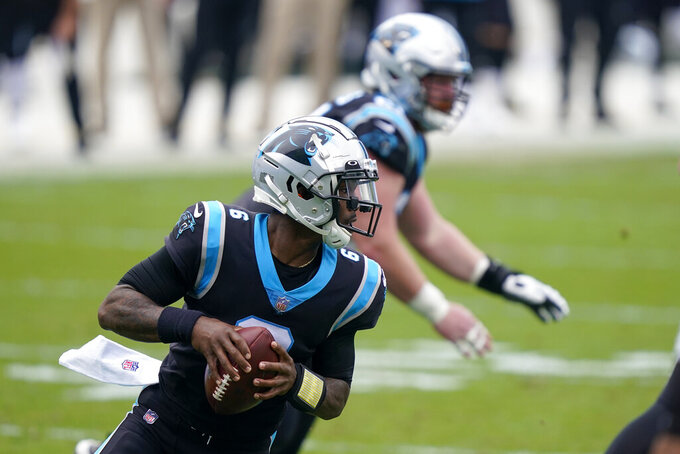 Carolina Panthers quarterback P.J. Walker looks tp pass during the first half of an NFL football game against the Detroit Lions Sunday, Nov. 22, 2020, in Charlotte, N.C. (AP Photo/Gerry Broome)
