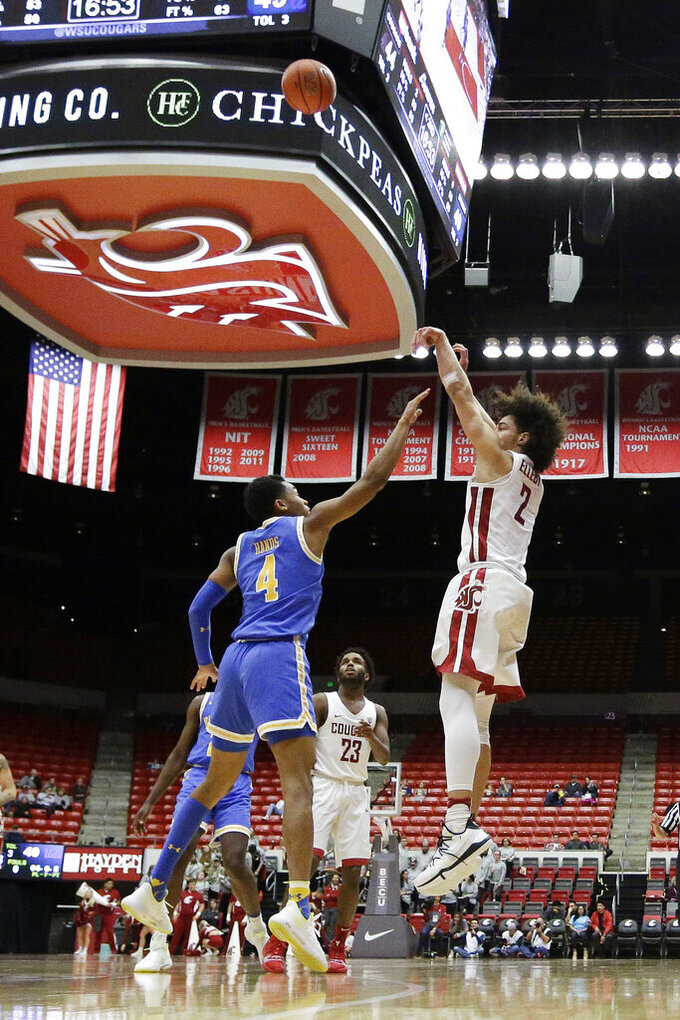Washington State forward CJ Elleby (2) shoots over UCLA guard Jaylen Hands (4) during the second half of an NCAA college basketball game in Pullman, Wash., Wednesday, Jan. 30, 2019. UCLA won 87-67. (AP Photo/Young Kwak)