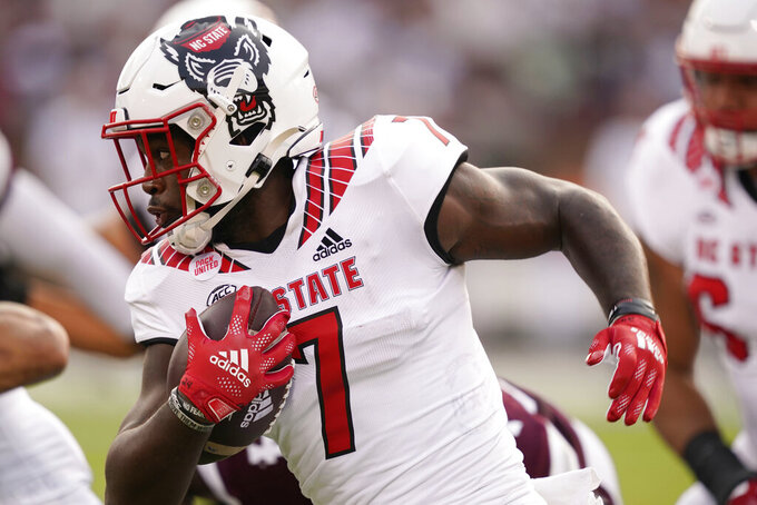 North Carolina State running back Zonovan Knight (7) runs upfield against Mississippi State during the first half of an NCAA college football game in Starkville, Miss., Saturday, Sept. 11, 2021. (AP Photo/Rogelio V. Solis)