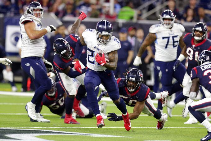 Tennessee Titans running back Derrick Henry (22) breaks away from Houston Texans linebacker Peter Kalambayi (58) to run for a 53-yard touchdown during the second half of an NFL football game Sunday, Dec. 29, 2019, in Houston. The run moved Henry into first place for the season rushing record. The Titans won 35-14. (AP Photo/Michael Wyke)