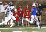 SMU running back Braeden West (6) runs past TCU cornerback Julius Lewis (24) for a touchdown during the first quarter of an NCAA college football game Friday, Sept. 7, 2018, in Dallas. (AP Photo/Jim Cowsert)