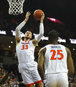 Virginia's center Jack Salt (33) takes a shot during the second half of an NCAA college basketball game against Marshall on Monday, Dec. 31, 2018, in Charlottesville, Va. Virginia beat Marshall 100-64. (AP Photo/Zack Wajsgras)