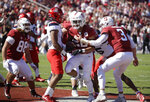 Stanford's Cameron Scarlett, center, is congratulated by quarterback K.J. Costello (3) after scoring a touchdown against Arizona during the first half of an NCAA college football game Saturday, Oct. 26, 2019, in Stanford, Calif. (AP Photo/Ben Margot)