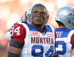 FILE - In this Aug. 7, 2014, file photo, Montreal Alouettes' Michael Sam and teammates warm up for a Canadian Football League game against the Ottawa Redblacks in Ottawa, Ontario.    (Justin Tang/The Canadian Press via AP, File)
