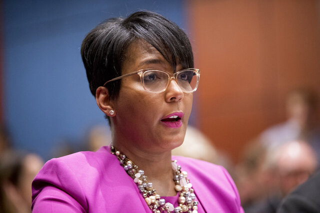FILE - In this July 17, 2019 file photo shows Atlanta Mayor Keisha Lance Bottoms speaks during a Senate Democrats' Special Committee on the Climate Crisis on Capitol Hill in Washington. Georgia officials are investigating a racist text received by the Atlanta mayor. Attorney General Chris Carr directed his office's prosecution division to investigate who sent the text, spokeswoman Katie Byrd said Friday, April 24, 2020. (AP Photo/Andrew Harnik)