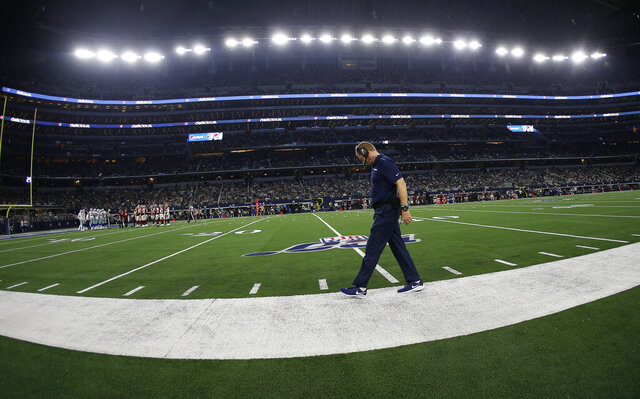Dallas Cowboys head coach Jason Garrett walks the sideline during the second half of an NFL football game against the Washington Redskins in Arlington, Texas, Sunday, Dec. 15, 2019. (AP Photo/Ron Jenkins)