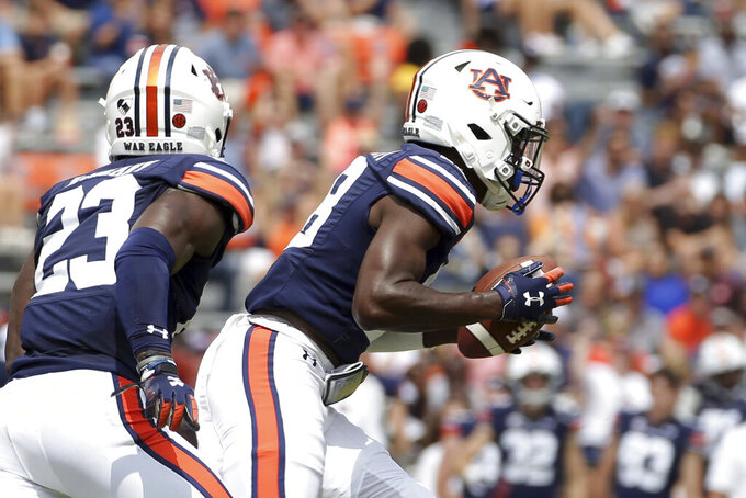 Auburn cornerback Nehemiah Pritchett (18) returns a blocked field goal attempt for a touchdown during the first half of an NCAA football game against Alabama State, Saturday, Sept. 11, 2021, in Auburn, Ala. (AP Photo/Butch Dill)