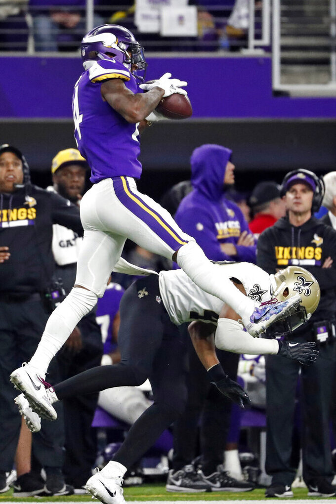 FILE - In this Jan. 14, 2018, file photo, Minnesota Vikings wide receiver Stefon Diggs (14) makes a catch over New Orleans Saints free safety Marcus Williams (43) on his way to the winning touchdown late in the second half of an NFL divisional football playoff game in Minneapolis. Marcus Williams asserts that he became a better player in the past year, although his numbers didn't show it. He enters Year 3 aiming to live up to high expectations, even if he may never completely live down a missed tackle in Minnesota that brought a ruinous end to his rookie season.  (AP Photo/Jeff Roberson, File)
