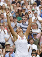Czech Republic's Barbora Strycova celebrates winning a women's quarterfinal match against Britain's Johanna Konta on day eight of the Wimbledon Tennis Championships in London, Tuesday, July 9, 2019. (AP Photo/Kirsty Wigglesworth)