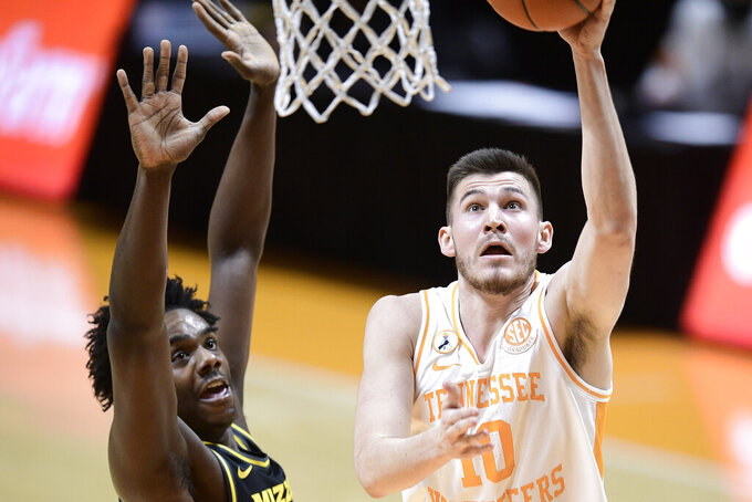 Tennessee forward John Fulkerson (10) shoots during an NCAA college basketball game in Knoxville, Tenn., Saturday, Jan. 23, 2021. (Calvin Mattheis/Knoxville News Sentinel via AP, Pool)