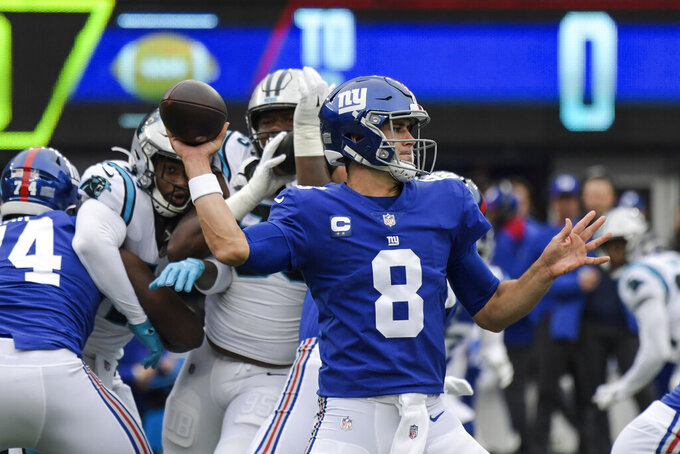 New York Giants quarterback Daniel Jones (8) throws a pass during the first half of an NFL football game against the Carolina Panthers, Sunday, Oct. 24, 2021, in East Rutherford, N.J. (AP Photo/Bill Kostroun)