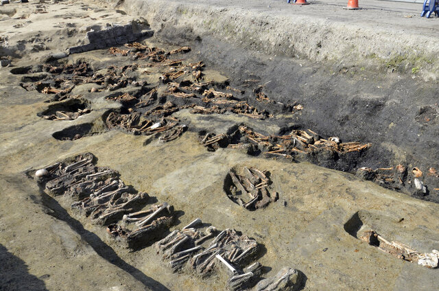 This undated photo provided Wednesday, Aug. 26, 2020, by Osaka City Cultural Properties Association shows human bones found at the north section of the