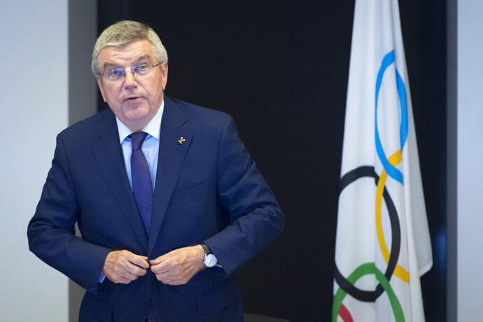 International Olympic Committee (IOC) president Thomas Bach, from Germany, arrives for the opening of the executive board meeting of the International Olympic Committee (IOC) at the IOC headquarters, in Pully near Lausanne, Wednesday, May 22, 2019. (Laurent Gillieron/Keystone via AP)