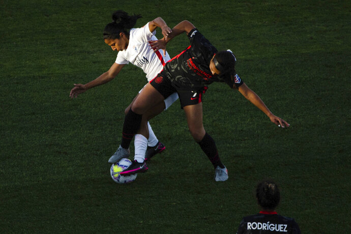 Portland Thorns' Sophia Smith, right, and OL Reign's Shirley Cruz battle for possession during the first half of an NWSL soccer match at Cheney Stadium in Tacoma, Wash., Saturday, Oct. 10, 2020. (Joshua Bessex/The News Tribune via AP)