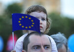 A child holds the European Union flag during a pro-Europe event dubbed