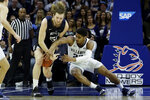 Villanova's Jermaine Samuels, right, battles with Butler's Nate Fowler for a loose ball during the first half of an NCAA college basketball game, Saturday, March 2, 2019, in Philadelphia. (AP Photo/Matt Slocum)