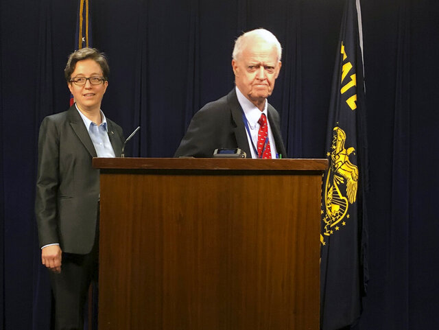 House Speaker Tina Kotek, left, and Senate President Peter Courtney appear before the press on Thursday, March 5, 2020, after Oregon's 2020 legislative session abruptly ended early amid an impasse with minority Republicans over a climate change bill and their tactic of walking out to deny a quorum and prevent the Senate and House from voting on bills. (AP Photo/Andrew Selsky)