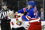 New York Rangers' Tony DeAngelo, right, punches Ottawa Senators' J.C. Beaudin during the first period of an NHL hockey game Monday, Nov. 4, 2019, in New York. (AP Photo/Frank Franklin II)
