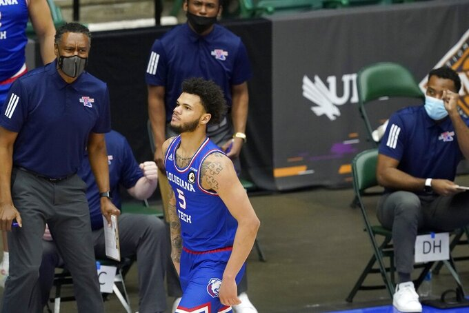 Louisiana Tech guard Kalob Ledoux (5) runs to the other end of the court after hitting a 3-point shot the second half of the team's NCAA college basketball game against Western Kentucky in the quarterfinals of the NIT, Thursday, March 25, 2021, in Frisco, Texas. (AP Photo/Tony Gutierrez)