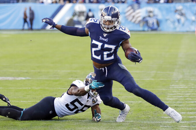 Tennessee Titans running back Derrick Henry (22) gets past Jacksonville Jaguars linebacker Quincy Williams (56) in the first half of an NFL football game Sunday, Nov. 24, 2019, in Nashville, Tenn. (AP Photo/James Kenney)