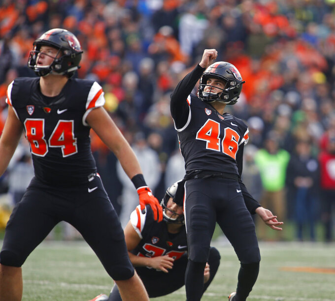 Oregon State place kicker Jordan Choukair (46) and Teagan Quitoriano (84) watch as Choukair's field goal-attempt goes wide in the first half of an NCAA college football game against Oregon in Corvallis, Ore., on Friday, Nov. 23, 2018. (AP Photo/Timothy J. Gonzalez)