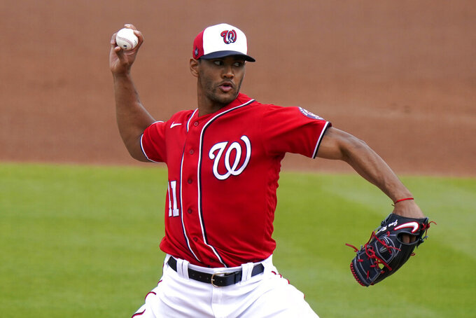 Washington Nationals starting pitcher Joe Ross throws during the first inning of a spring training baseball game against the New York Mets, Monday, March 8, 2021, in West Palm Beach, Fla. (AP Photo/Lynne Sladky)
