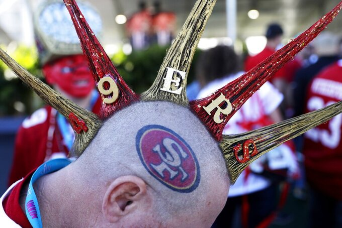San Francisco 49ers fan Vic Claveau arrives before the NFL Super Bowl 54 football game between the San Francisco 49ers and Kansas City Chiefs Sunday, Feb. 2, 2020, in Miami Gardens, Fla. (AP Photo/Seth Wenig)