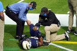 Los Angeles Chargers running back Justin Jackson works with trainers after an injury during the first half of an NFL football game against the Las Vegas Raiders, Sunday, Nov. 8, 2020, in Inglewood, Calif. (AP Photo/Ashley Landis)
