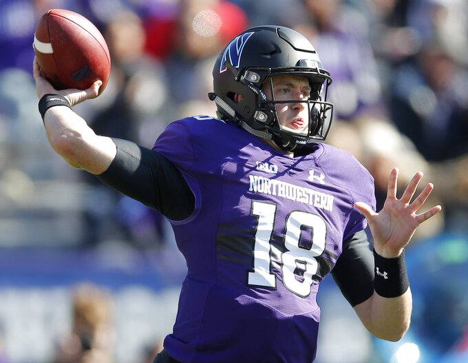 Northwestern's Clayton Thorson throws a pass against Nebraska during the first half of an NCAA college football game Saturday, Oct. 13, 2018, in Evanston, Ill. (AP Photo/Jim Young)