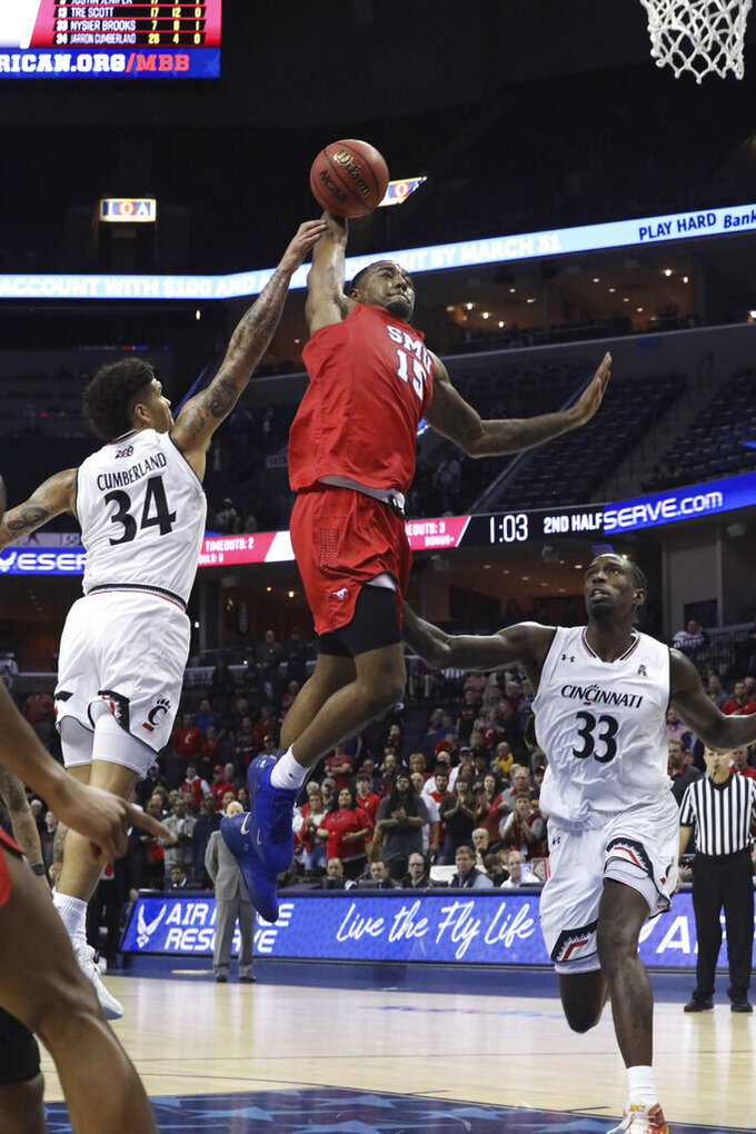 SMU's Isiaha Mike goes up for a shot between Cincinnati's Jarron Cumberland and Nyster Brooks during the second half of an NCAA college basketball game at the American Athletic Conference men's tournament Friday, March 15, 2019, in Memphis, Tenn. (AP Photo/Troy Glasgow)