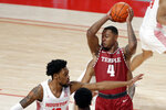Temple forward J.P. Moorman II (4) passes the ball over Houston forward J'Wan Roberts, left, during the first half of an NCAA college basketball game Tuesday, Dec. 22, 2020, in Houston. (AP Photo/Michael Wyke)