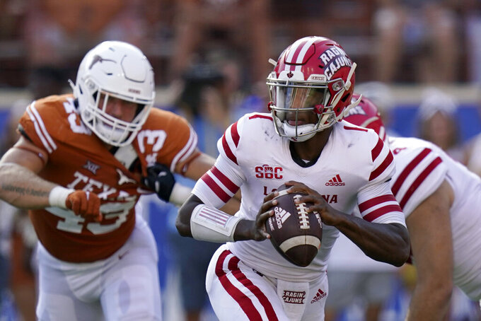 Louisiana-Lafayette quarterback Levi Lewis (1) is pressured as he looks to throw a pass against Texas during the second half of an NCAA college football game Saturday, Sept. 4, 2021, in Austin, Texas. (AP Photo/Eric Gay)