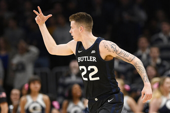 Butler forward Sean McDermott (22) gestures after a 3-point basket during the second half of the team's NCAA college basketball game against Georgetown, Tuesday, Jan. 28, 2020, in Washington. Butler won 69-64. (AP Photo/Nick Wass)