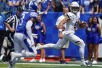 Toledo quarterback Mitchell Guadagni (6) runs for a touchdown during the first half of the NCAA college football game against Kentucky, Saturday, Aug. 31, 2019, in Lexington, Ky. (AP Photo/Bryan Woolston)