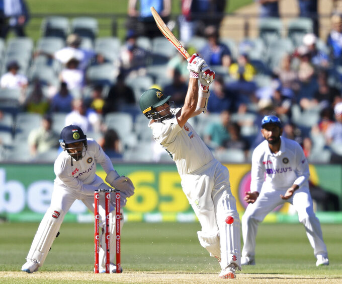 Australia's Joe Burns plays a shot against India on the third day of their cricket test match at the Adelaide Oval in Adelaide, Australia, Saturday, Dec. 19, 2020. (AP Photo/David Mariuz)