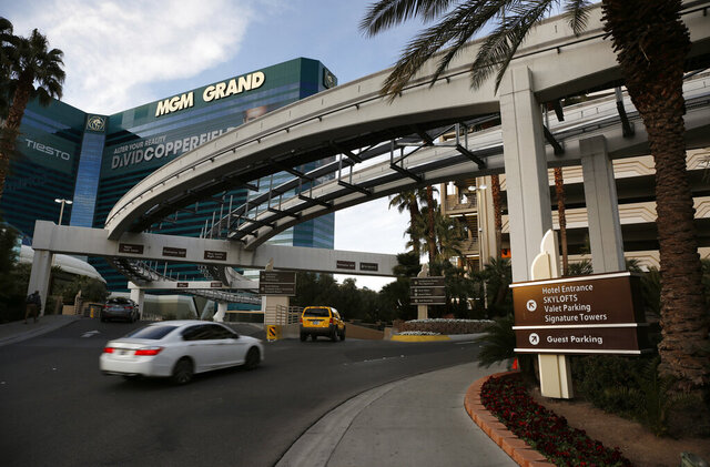 FILE - In this Jan. 14, 2016, file photo, cars drive into the MGM Grand hotel and casino in Las Vegas. Casino giant MGM Resorts International says it won't charge parking fees at its Las Vegas Strip resorts when they are allowed to reopen after being closed due to the coronavirus pandemic. No reopening date has been set. But a spokesman for the owner of properties including Bellagio, MGM Grand, New York-New York and Mandalay Bay says in a statement Tuesday, May 19, 2020, that free parking will be a way to welcome guests back. (AP Photo/John Locher, File)