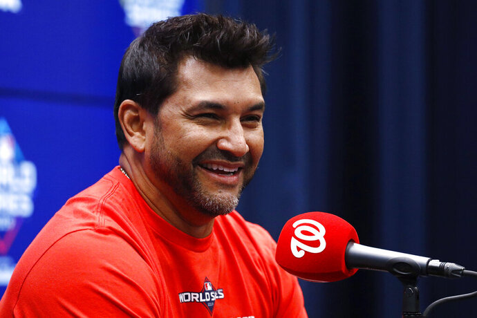 Washington Nationals manager Dave Martinez smiles during a news conference Thursday, Oct. 24, 2019, in Washington. The Nationals and the Houston Astros are scheduled to play Game 3 of baseball's World Series on Friday. (AP Photo/Patrick Semansky)