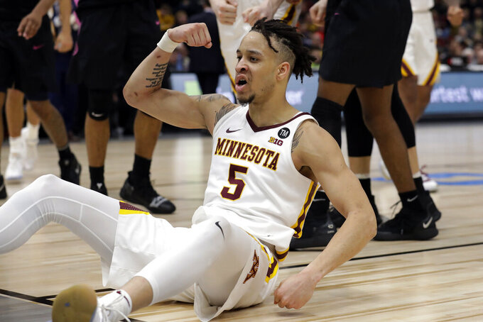 Minnesota's Amir Coffey (5) reacts during the overtime of an NCAA college basketball game against the Penn State in the second round of the Big Ten Conference tournament, Thursday, March 14, 2019, in Chicago. Minnesota won 77-72 in overtime. (AP Photo/Nam Y. Huh)