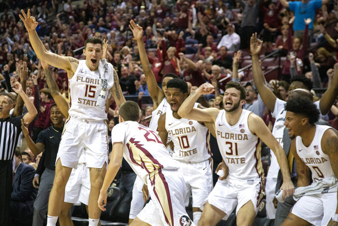 Florida State players celebrate after guard Travis Light (20) hitting two 3-pointers in the final minute of an NCAA college basketball game against Miami in Tallahassee, Fla., Saturday, Feb. 8, 2020. Florida State defeated Miami 99-81. (AP Photo/Mark Wallheiser)