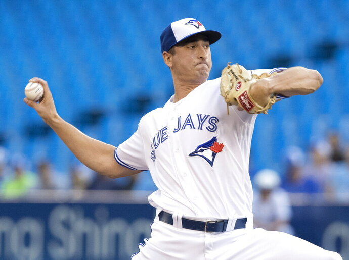 Toronto Blue Jays starting pitcher Jacob Waguespack throws to a Seattle Mariners batter during the first inning of a baseball game Friday, Aug. 16, 2019, in Toronto. (Fred Thornhill/The Canadian Press via AP)