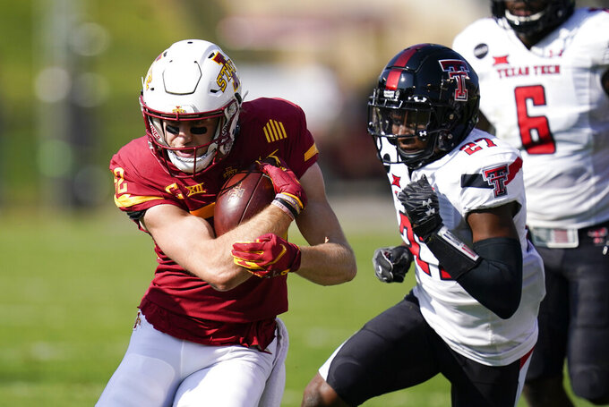 Iowa State wide receiver Landen Akers runs from Texas Tech defensive back Alex Hogan, right, after catching a pass during the first half of an NCAA college football game, Saturday, Oct. 10, 2020, in Ames, Iowa. (AP Photo/Charlie Neibergall)