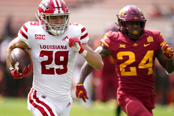 Louisiana-Lafayette wide receiver Peter LeBlanc runs from Iowa State defensive back D.J. Miller Jr. (24) during a 78-yard touchdown catch during the second half of an NCAA college football game, Saturday, Sept. 12, 2020, in Ames, Iowa. Louisiana-Lafayette won 31-14. (AP Photo/Charlie Neibergall)