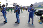 Bubba Wallace, right, stands for the National Anthem before the start of a NASCAR Cup Series auto race Sunday, July 12, 2020, in Sparta, Ky. (AP Photo/Mark Humphrey)