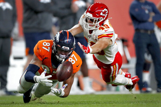 Denver Broncos tight end Noah Fant (87) can't make the catch as Kansas City Chiefs defensive back Daniel Sorensen (49) defends during the second half of an NFL football game, Thursday, Oct. 17, 2019, in Denver. (AP Photo/David Zalubowski)