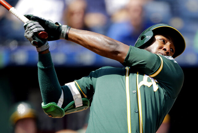 FILE - In this Aug. 29, 2019, file photo, Oakland Athletics' Jurickson Profar watches his two-run home run during the fourth inning of a baseball game against the Kansas City Royals in Kansas City, Mo. Switch-hitting second baseman Profar has been acquired by the San Diego Padres from the Athletics in exchange for catcher Austin Allen and a player to be named. The trade was announced Monday, Dec. 2, 2019, with the baseball winter meetings in San Diego less than a week away. (AP Photo/Charlie Riedel, File)