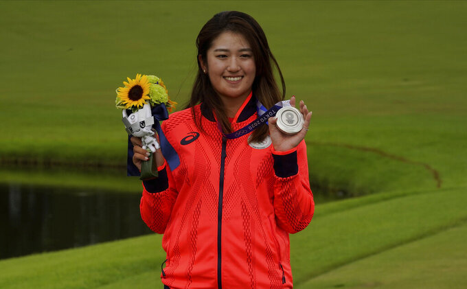 Mone Inami, of Japan, poses with her silver medal, won in the women's golf event at the 2020 Summer Olympics, Saturday, Aug. 7, 2021, at the Kasumigaseki Country Club in Kawagoe, Japan. (AP Photo/Matt York)