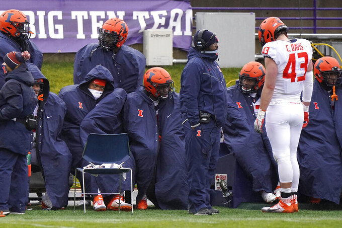 Illinois players react as they sit on the bench during the second half of an NCAA college football game against Northwestern in Evanston, Ill., Saturday, Dec. 12, 2020. Northwestern won 28-10. (AP Photo/Nam Y. Huh)