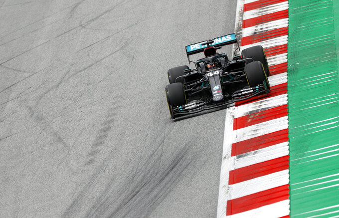Mercedes driver Lewis Hamilton of Britain steers his car during the second practice session at the Red Bull Ring racetrack in Spielberg, Austria, Friday, July 3, 2020. The Austrian Formula One Grand Prix will be held on Sunday. (Leonhard Foeger/Pool via AP)
