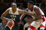 United States' Khris Middleton, left, is guarded by Canada's Melvin Ejim during their exhibition basketball game in Sydney, Australia, Monday, Aug. 26, 2019. (AP Photo/Rick Rycroft)